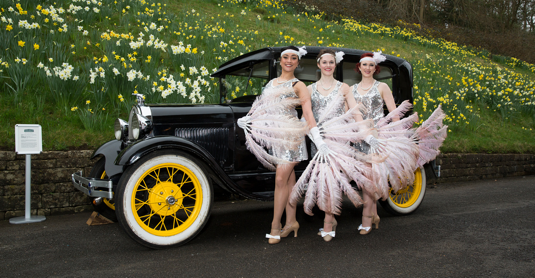 Dancers and cars