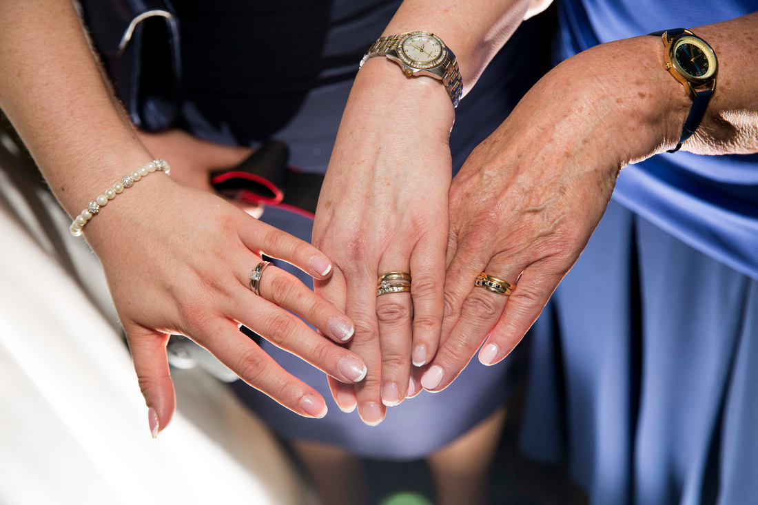 Three generations of wedding rings - Bride, mother & grandmother