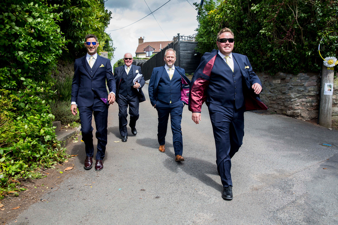groom groomsmen walk to church