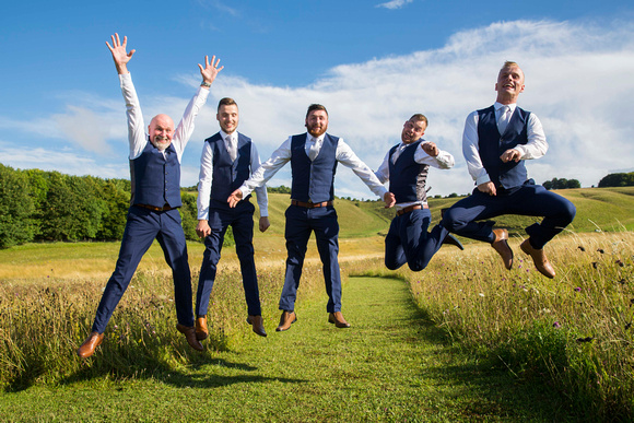 Groomsmen jumping in the air at Wellington Farm