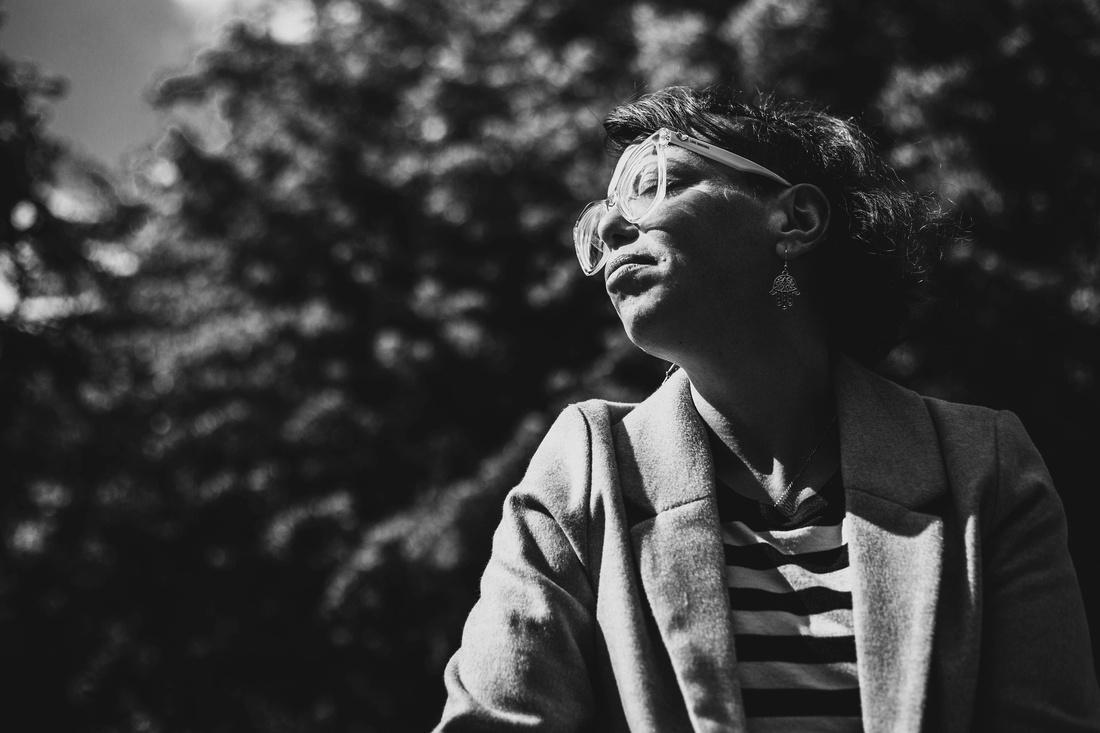 female portrait looking into sun