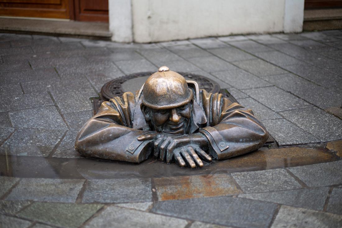 Cumil the Sewer Worker bronze statue in Bratislava