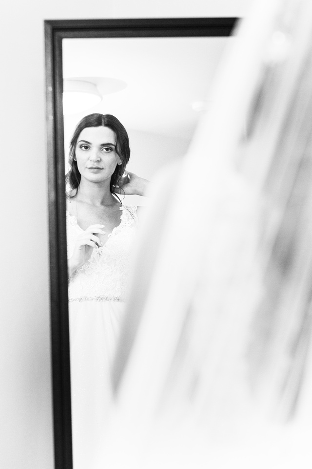 Portrait of bride in mirror getting ready