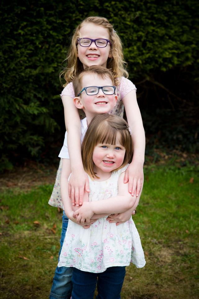 children standing in height order