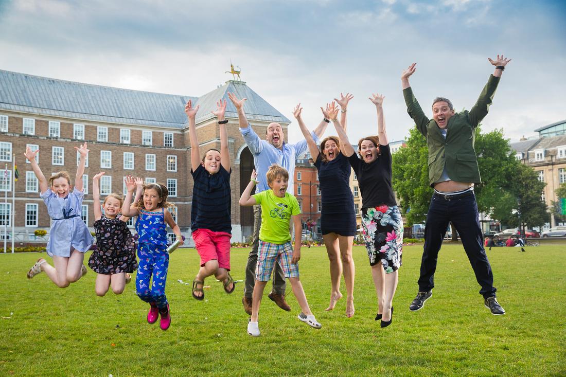 Jumping group shot by City Hall, Bristol