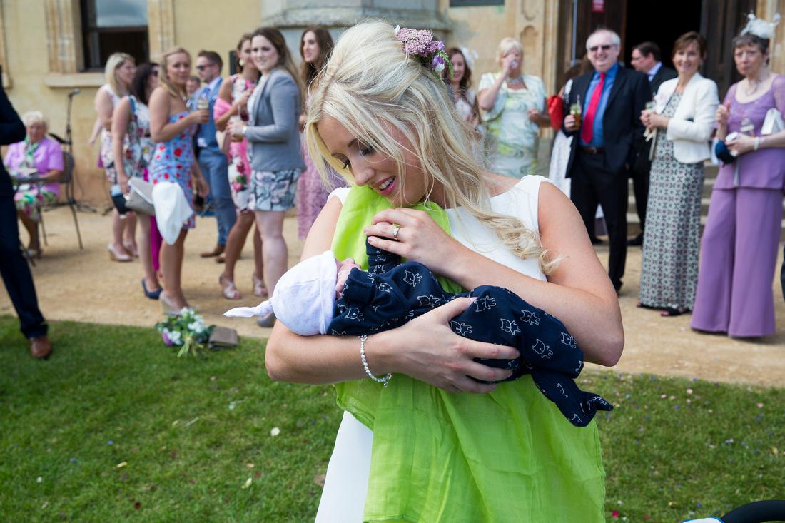 Bride with newborn baby