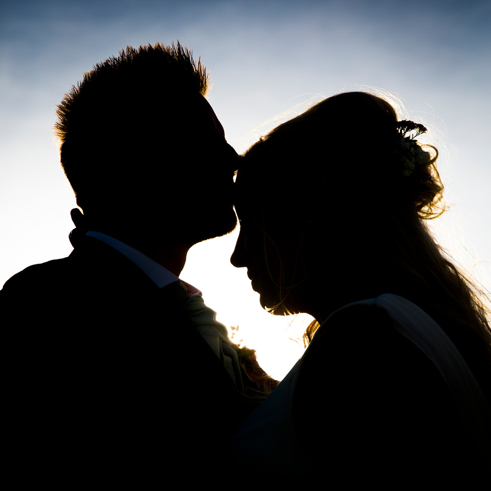 Silhoette kiss at sunset, Ashton Court Mansion, Bristol