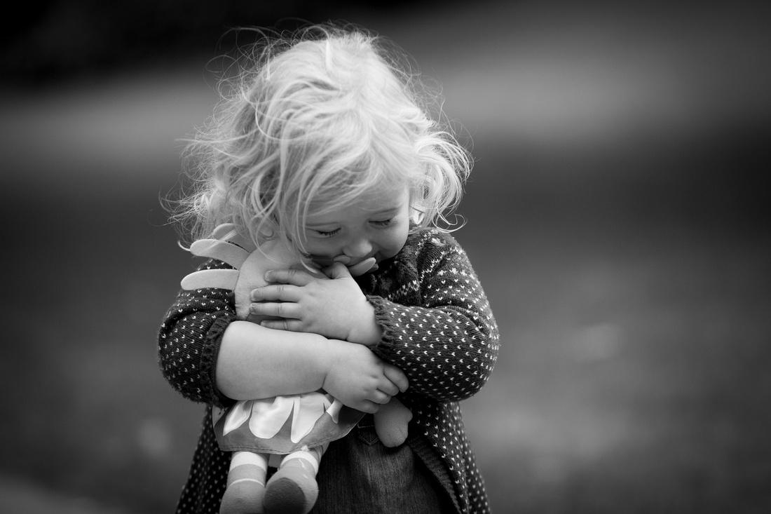 teddy cuddles hug baby portrait