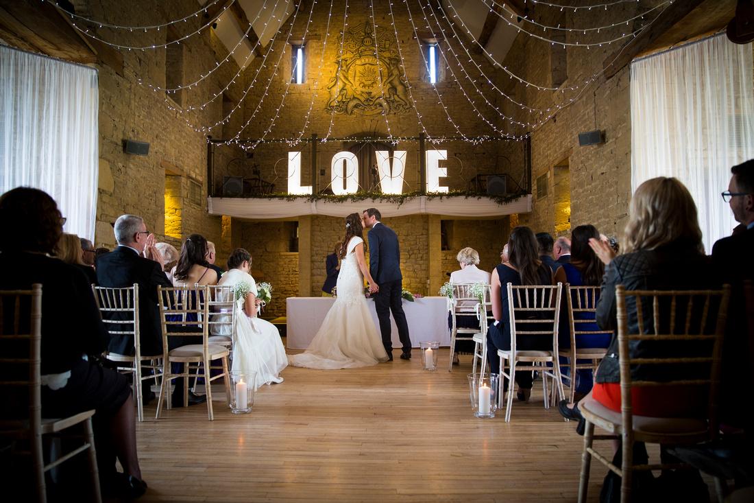Bride & groom wedding ceremony kiss love letters