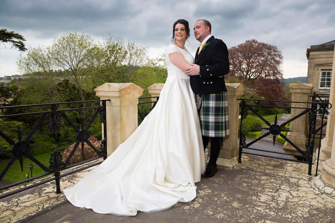 Bride and groom wedding photo on balcony of the Grange Suite, Bath Spa Hotel
