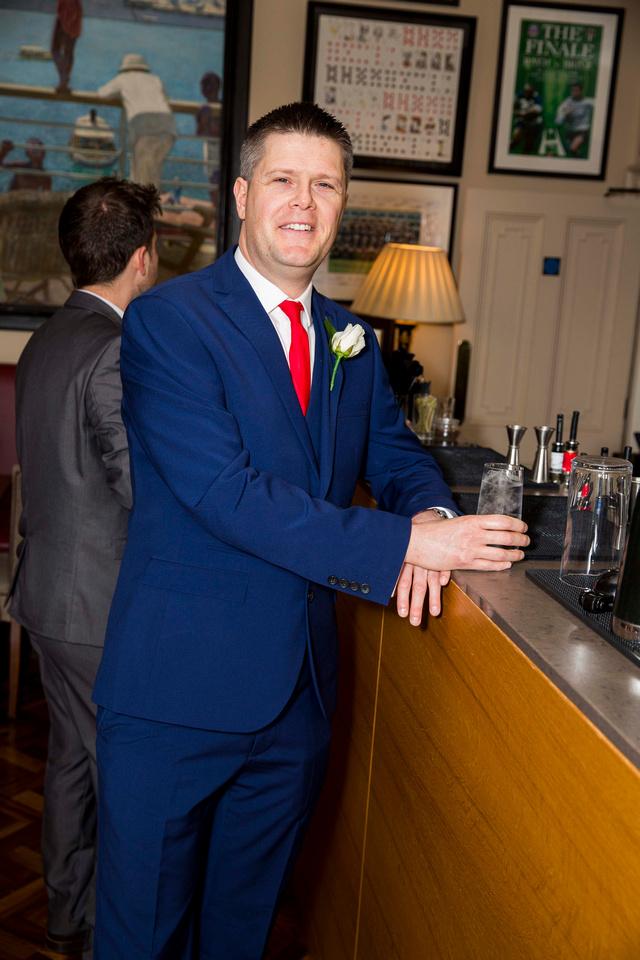 bath priory hotel wedding groom at bar