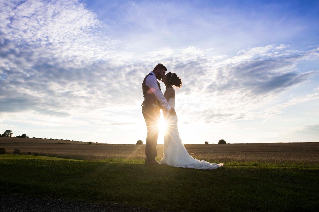 bride and groom sunset Wellington Barn wedding