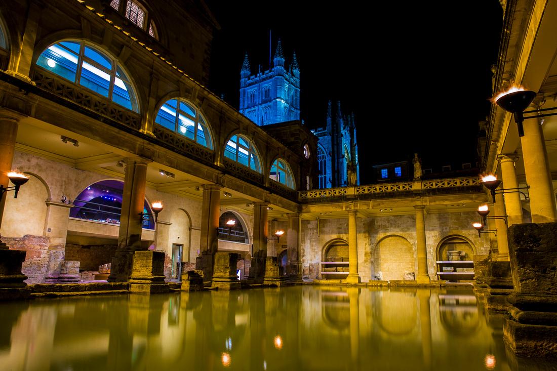 Roman Baths by Bath Abbey at night
