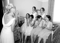 Bridesmaids seeing dress for the first time