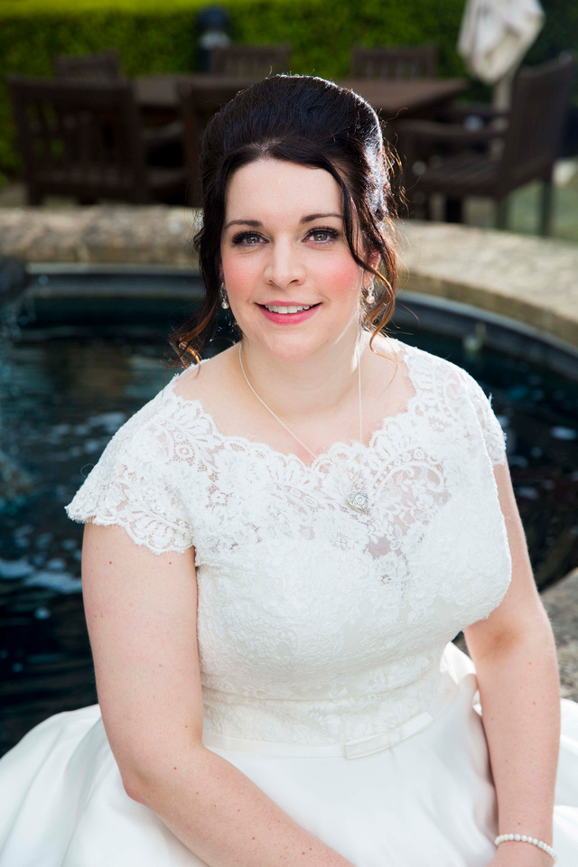 Bride by fountain at Macdoanld Bath Spa Hotel