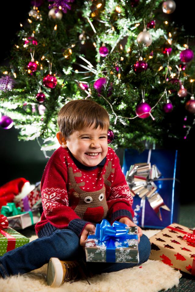 Christmas tree presents boy portrait